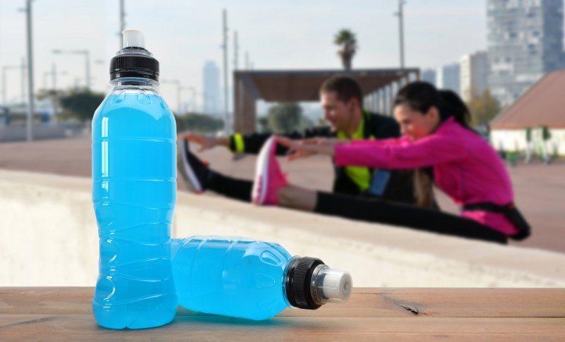 Sports drinks next to stretching couple