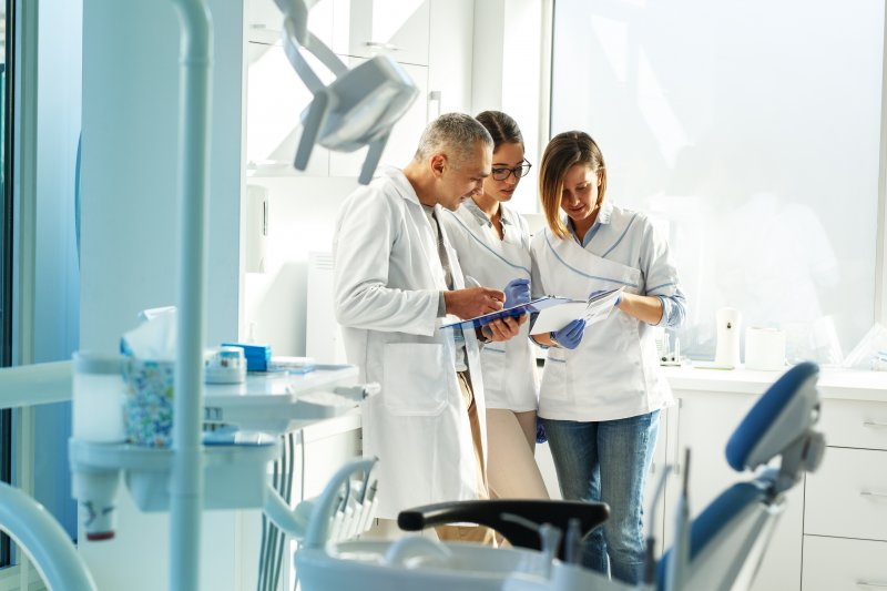 A team of dentists at a multi-specialty practice